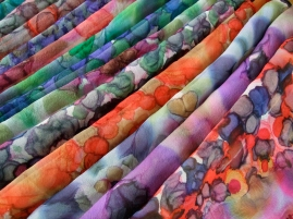 Selection of clamped-resist shibori scarves on silk gauze