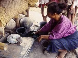 Indigo dyer, Flores, Indonesia, preparing to dye yarn for ikat