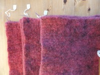 Three graded samples of dyed felt