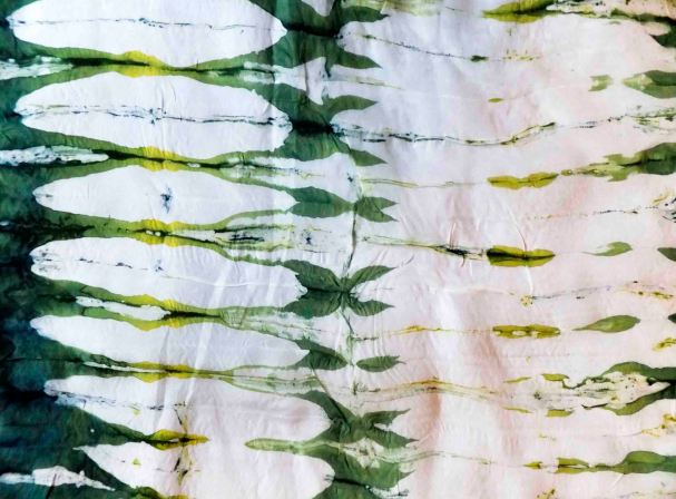 Sample of student's work in which accordion pleated silk was dipped into wax and then dyed