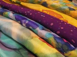 A variety of students' work including wax resist and shibori