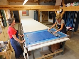 The squeegee is dragged towards the printer on the left keeping the presure even