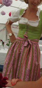 A wedding dirndl. An apron knotted at the front means the wearer is unmarried