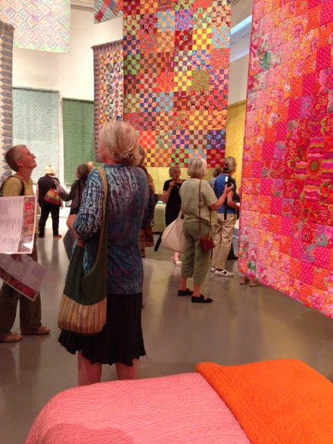 Summer School visitors at the Welsh Quilt Centre showing contemporary quilts also on display