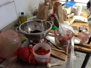 Measuring, grinding and sieving are part of the dye process