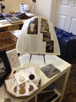 Laura's Loom display unit, showing her article in the Journal