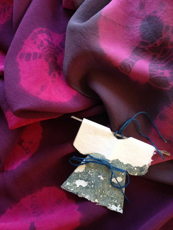 Cochineal-dyed scarves and indigo dye-god