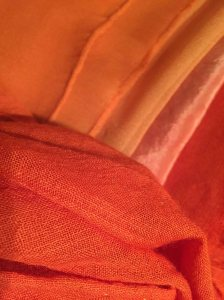 Silks and wool dyed with various strengths of Indian Madder (and correct mordant)