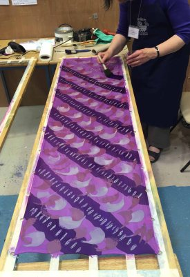 Finishing touches on a crêpe de Chine scarf