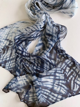 Indigo dyed; folded and wrapped
